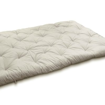 Outstretched wool-filled and tufted mattress topper.