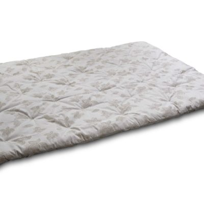 Outstretched wool-filled mattress pad with a tufted, neutrally colored floral print.