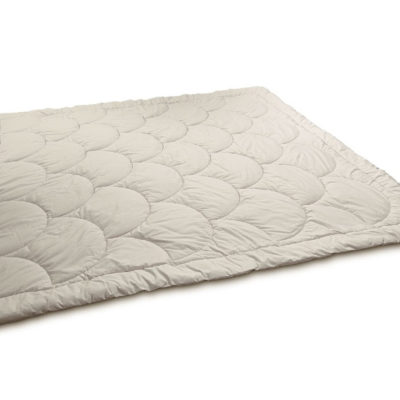 Outstretched wool comforter with a shell pattern stitching. Against white background.