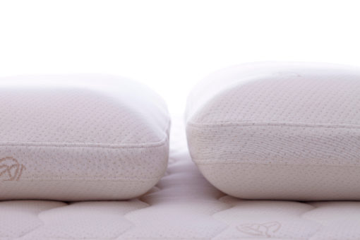 Two latex pillows side by side showing the difference in heights.